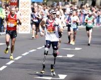 2013 London Marathon. London, UK - April 21, 2013: Disabled runner in the crowds of London Marathon runners. The London Marathon is next to New York, Berlin Royalty Free Stock Photos