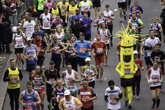 2015, London Marathon. London, UK - April 26, 2015: Participant wearing funny costume in the crowds of runners of London Marathon. The London Marathon is next to Royalty Free Stock Image