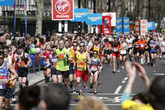 2013 London Marathon. London, UK - April 21, 2013: Runners in London Marathon. The London Marathon is next to New York, Berlin, Chicago and Boston to the World Royalty Free Stock Photo