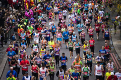 2015, London Marathon. London, UK - April 26, 2015: Runners in London Marathon. The London Marathon is next to New York, Berlin, Chicago and Boston to the World Royalty Free Stock Images