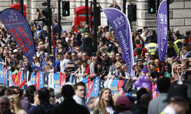 2013 London Marathon. London, UK - April 21, 2013: Supporters watch and cheer thousands of marathon runners. The London Marathon is next to New York, Berlin Stock Images