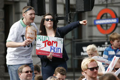2013 London Marathon. London, UK - April 21, 2013: Supporters watch and cheer thousands of marathon runners. The London Marathon is next to New York, Berlin Stock Photography