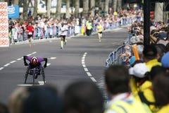 2013 London Marathon. London, UK - April 21, 2013: Wheelchair racing contestants in the crowds of London Marathon runners. The London Marathon is next to New Stock Photo