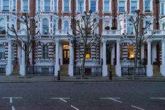 London - March 30: Iconic traditional row of town houses at night in Notting Hill on March 30, 2017 Stock Images