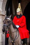 LONDON - MARCH 6 : Lifeguard of the Queens Household Cavalry on Royalty Free Stock Photos