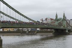 LONDON, 10 MARCH 2018: Spectators on Hammersmith Bridge waiting to watch the Womens Head of the River Race WEHORR 2018. On the River Thames, London, England UK Royalty Free Stock Image