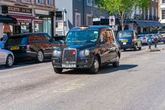 London black cab parked on a street in Knightsbridge, London. LONDON MAY 05, 2018: The iconic London black cab parked on a street in Knightsbridge, London.The royalty free stock photography