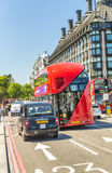 LONDON - MAY 2013: Red Double Decker bus along city streets. Lon Stock Image