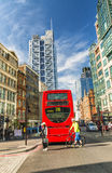 LONDON - MAY 2013: Red Double Decker bus along city streets. Lon Stock Photography