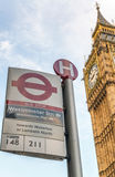 LONDON - MAY 2013: Subway sign near Big Ben Tower. London attrac. Ts 30 million tourists annually Royalty Free Stock Image