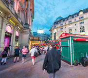 LONDON - MAY 15, 2015: Tourists and locals around Piccadilly Cir Stock Photo