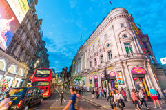 LONDON - MAY 15, 2015: Tourists and locals around Piccadilly Cir Royalty Free Stock Images