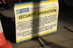 London Metropolitan Police sign in a street. London Metropolitan Police sign to tell people there is a security operation in the area Royalty Free Stock Images