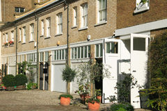 London mews houses. Elegant London mews houses in Kensington and Chelsea converted from old horse stables Royalty Free Stock Image