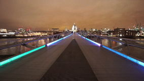 London Millennium Bridge leading to St Pauls Cathedral great night shot stock footage