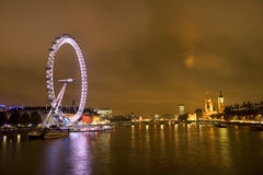 London Millennium Eye and big Benat night. London Millennium Eye and big Ben at night on a cloudy night Royalty Free Stock Image