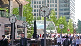London. Modern architecture of Canary Wharf business aria and clock on the main square. LONDON, UK - JULY 03, 2014: Modern architecture of Canary Wharf business stock footage