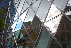 LONDON, Modern English architecture, glass texture with sky reflection. City of London Royalty Free Stock Photography