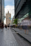 London modern office block and tower bridge. Office worker leaving office after work near the london business center with city hall and tower bridge as stock images