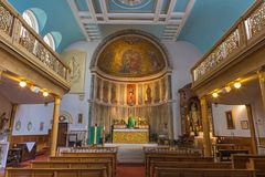 London - The nave of church Our Lady of the Assumption with mosaic of Coronation of Virgin Mary. LONDON, GREAT BRITAIN - SEPTEMBER 18, 2017: The nave of church Royalty Free Stock Image