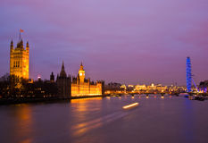 London at night. London Thames at night with the Parliament and the London Eye royalty free stock photos