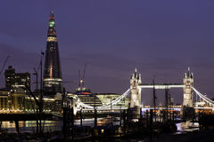 London by night. Renzo Piano's The Shard and Tower Bridge illumintated at dusk in London on July 5th 2012. The Shard is the tallest building in the European Royalty Free Stock Photos