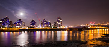 London by night sky with the full moon Royalty Free Stock Photo