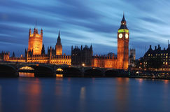 London night skyline. Scenic view of illuminated skyline of city of London with Houses or Parliament and Big Ben, river Thames in foreground royalty free stock photography