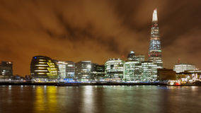 London Night skyline across the Thames. Night shot across the River Thames with The Shard and City Hall in the background Stock Photos