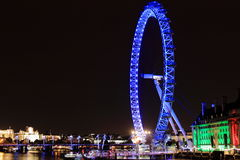 London night skyline with the London Eye. London night skyline with the ilumination of the London Eye and the buildings next to River Thames Royalty Free Stock Images
