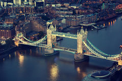 London at night with urban architectures and Tower Bridge Royalty Free Stock Photography
