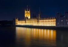 London night view. House of Parliament and reflections on river Thames, London dusk Stock Photos