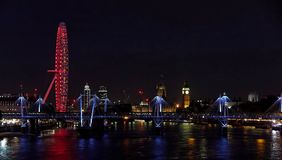London by night. London waterfront by night with red lights on London eye Stock Image