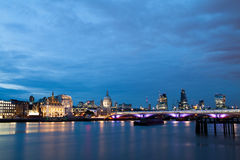 London nights from the piers with Canary Wharf view. On the blue hour Stock Photo