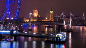 London Nightscape. Big Ben, the Houses of Parliament and the London Eye over the River Thames Stock Images
