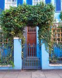 London, Notting hill, blue house entrance. London, Notting hill, colorful blue entrance with folliage and wooden door Royalty Free Stock Photography