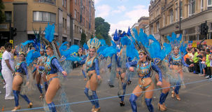 London, Notting Hill carnival. Parade of dancers ann costumes Royalty Free Stock Photography