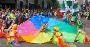 London, Notting Hill carnival. Parade of dancers and costumes Royalty Free Stock Images