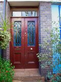 London, Notting hill, entrance with folliage and wooden door. London, Notting hill, colorful blue entrance with folliage and wooden door Stock Image