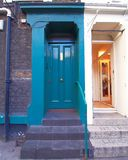 London Notting Hill, colorful blue green entrance door. London Notting Hill cozy neighbourhood, colorful blue green entrance door Stock Photography