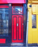 London, Notting hill, colorful entrance with red and yellow doors. London, Notting hill, colorful cozy home entrance with red and yellow doors Royalty Free Stock Images