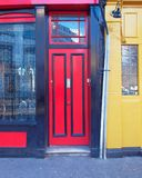 London, Notting hill, red and yellow doors. London, Notting hill, colorful entrance with red and yellow doors Stock Images