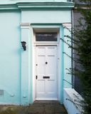 London, Notting hill, vintage house light blue front with white door. London, Notting hill cozy neighborhood, vintage house light blue front with white door Royalty Free Stock Image