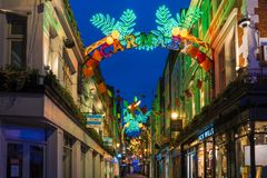 Christmas lights on Carnaby Street, London UK. LONDON - NOVEMBER 18, 2017: Christmas lights on Carnaby Street, London UK. Carnaby Christmas lights feature some Royalty Free Stock Photo
