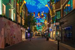 Christmas lights on Carnaby Street, London UK. LONDON - NOVEMBER 18, 2017: Christmas lights on Carnaby Street, London UK. Carnaby Christmas lights feature some Stock Photo