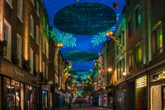 Christmas lights on Carnaby Street, London UK. LONDON - NOVEMBER 18, 2017: Christmas lights on Carnaby Street, London UK. Carnaby Christmas lights feature some Royalty Free Stock Images