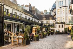 A typical view in London. London. November 2018. A view of the outdoor courtyard of the American bar at the stafford hotel in London stock photography