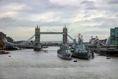LONDON - NOVEMBER 17 : View of Tower Bridge and two warships in Stock Photo