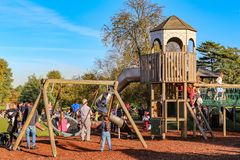 LONDON - OCT 25, 2017: Colorful playground on yard in the park where children have fun with there parents royalty free stock images