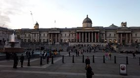 London - October 2019: time lapse at the National Gallery building and fountains on Trafalgar Square in the evening stock video footage
